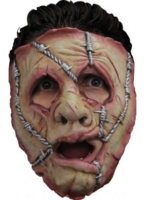 Маска изуродованного лица в колючей проволке